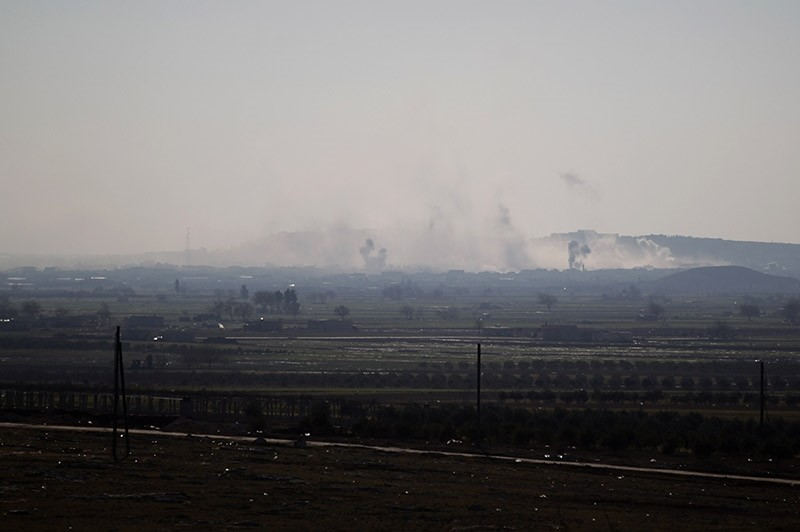 Smoke rises from Al-Bab as the opposition advance towards the town, in Syria January 22, 2017. (Reuters Photo)
