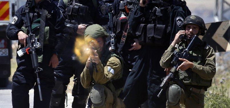 ISRAELI FORCES KILL 4 PALESTINIANS NEAR GAZA FENCE