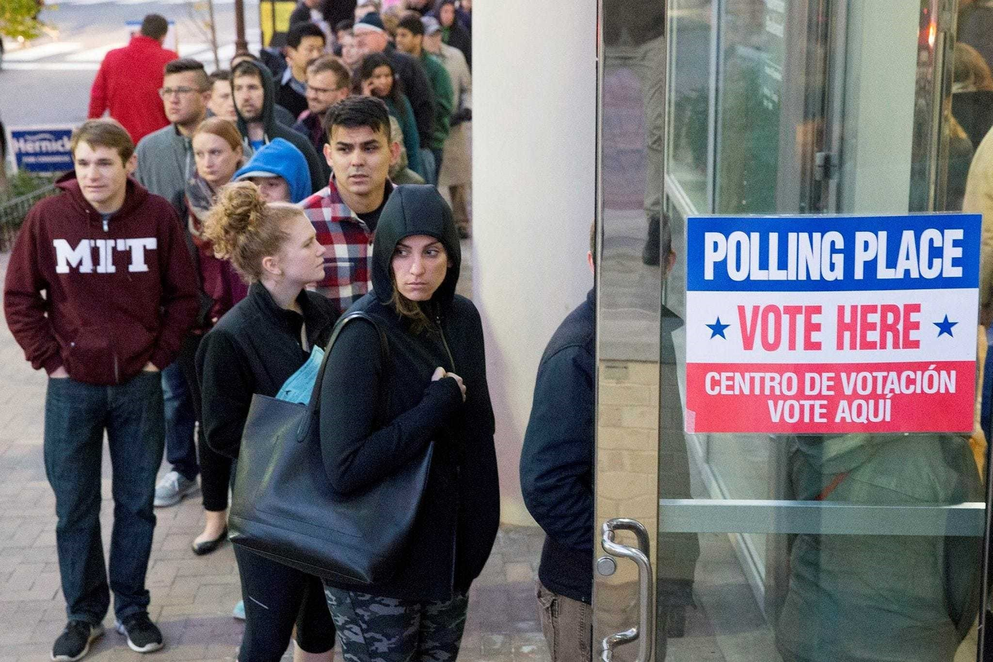 People wait in a line to enter a polling station to vote in the 2016 U.S. presidential election, in Arlington, Virginia, Nov. 8.