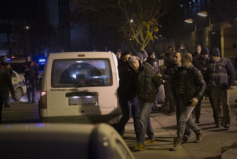 Police detain the man who opened fire into the air outside the US embassy in Ankara. (AA Photo)