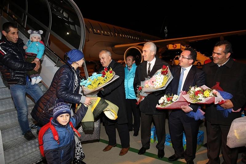 Turkish officials welcome Ahiska Turks at the airport, 18 November 2016. (AA Photo)