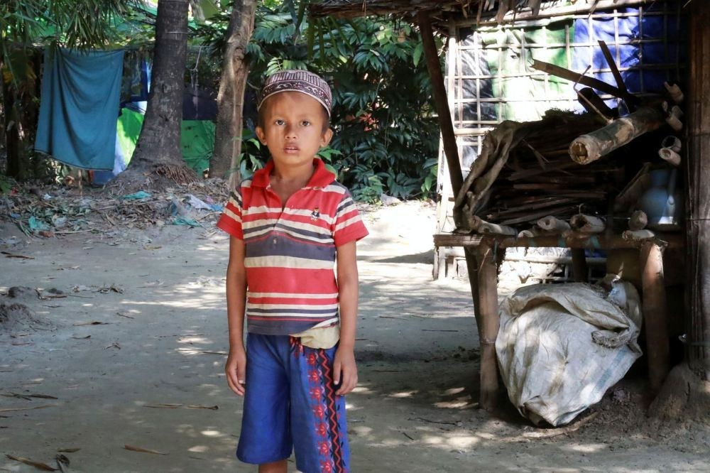 A Muslim boy stands in front of a house in Maungdaw, a town located in Myanmar's strife-torn Rakhine State near the Bangladesh border on Dec. 2.