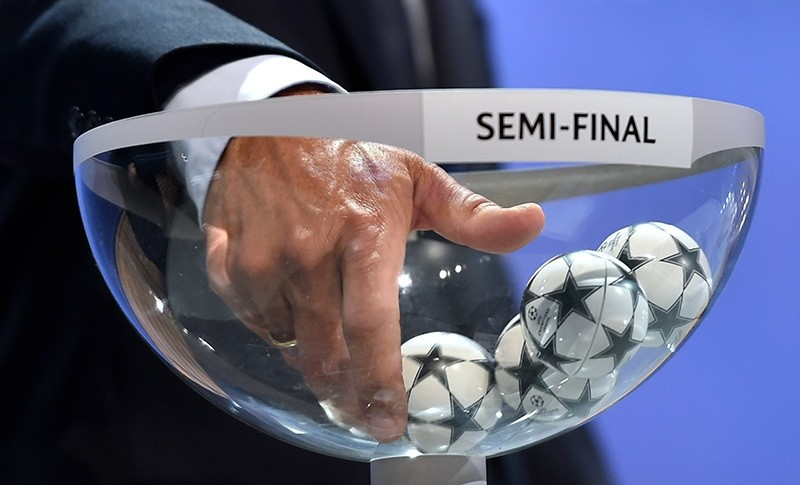 This file photo shows ambassador for the UEFA Champions League final in Berlin Karl-Heinz Riedle picks up a drawing ball during the draw for the UEFA Champions League semi-final matches at the UEFA headquarters in Nyon on April 24, 2015. (AFP Photo)