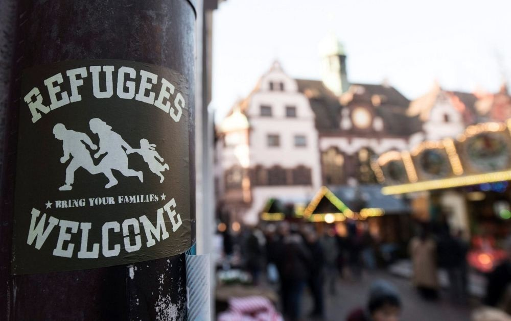 A sticker reading ,Refugees Welcome, can be seen in the inner city of Freiburg, Germany, Dec. 5. (EPA)