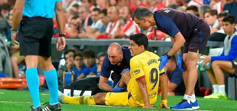 SUAREZ INJURED, JOINS MESSI ON BARCA TREATMENT TABLE