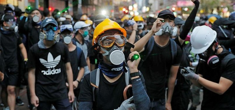 HONG KONGERS RALLY AGAINST GOVERNMENT UNDER STORMY SKIES