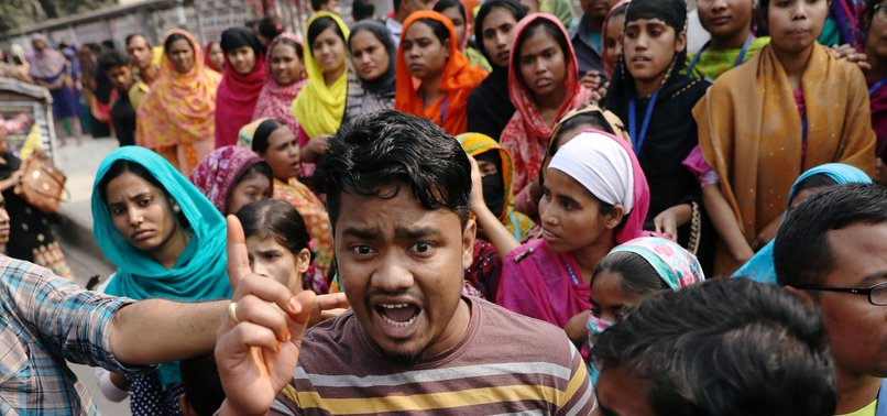 PROTESTING GARMENT WORKERS IN BANGLADESH REJECT RAISES