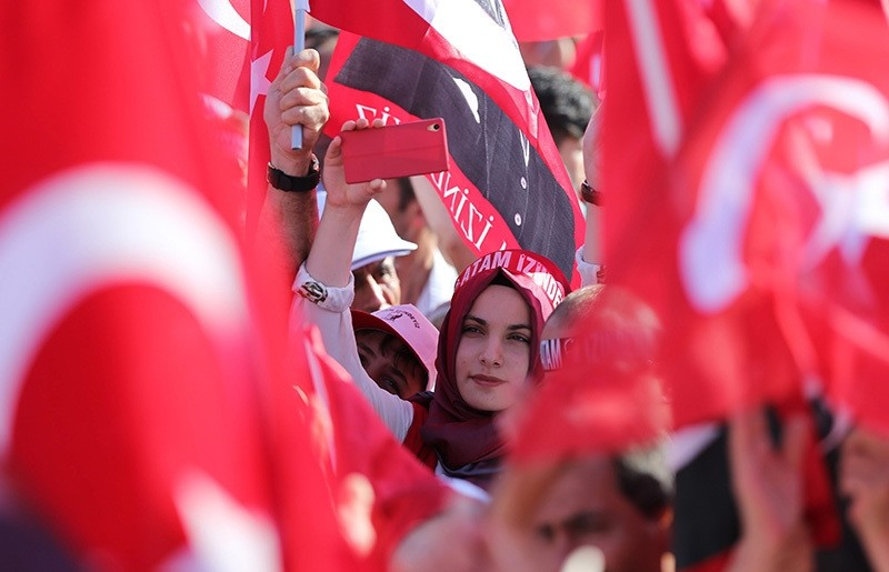 """A young woman wearing a headscarf seen attending to the democracy rally organized by center-left CHP. The headband reads: """"Forefather, we are on your path,"""" a slogan generally used by secular Turks referring to Atatürk. (EPA Photo)"""