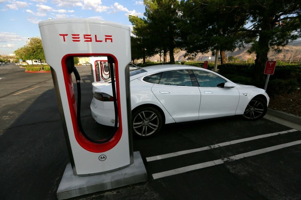 A Tesla Model S charges at a Tesla Supercharger station in Cabazon, California.