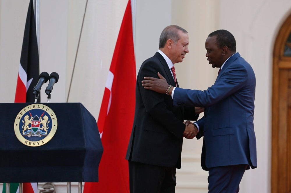 President Erdou011fan (L) shakes hands with Kenyatta at the end of their joint press conference at State House in Nairobi, Kenya. Erdou011fan & Turkish delegation were in Kenya to strengthen diplomatic & economic relations with the East African country.