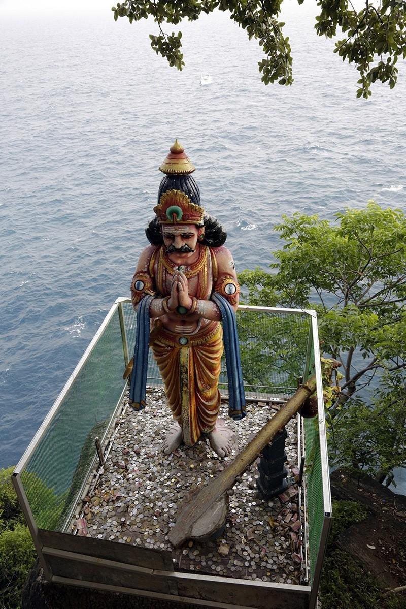 An image of a Hindu deity on the edge of the rocky cliff overlooking the Thiru Koneswaram Hindu temple. (EPA Photo)