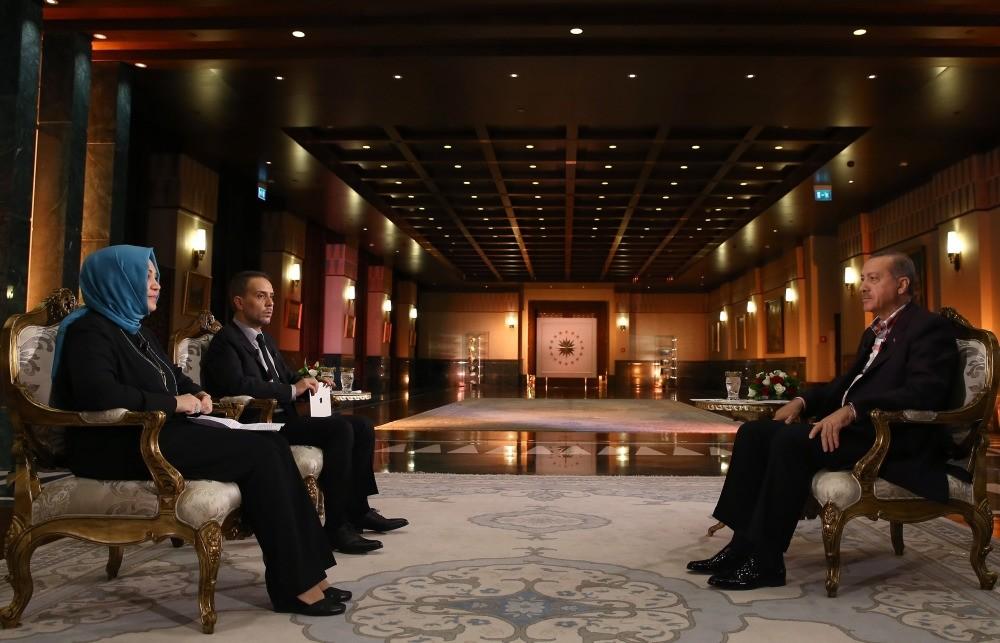 Daily Sabah columnists Hilal Kaplan and Melih Altu0131nok with President Erdou011fan at the Presidential Complex.