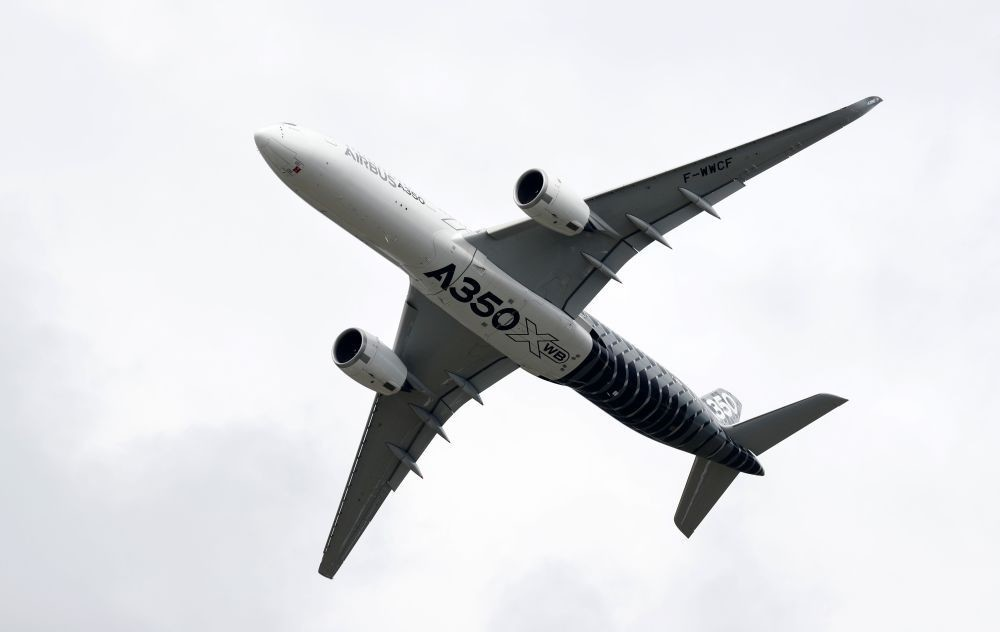An Airbus A350 jet airliner takes part at the Farnborough Airshow, south west of London, on July 12.