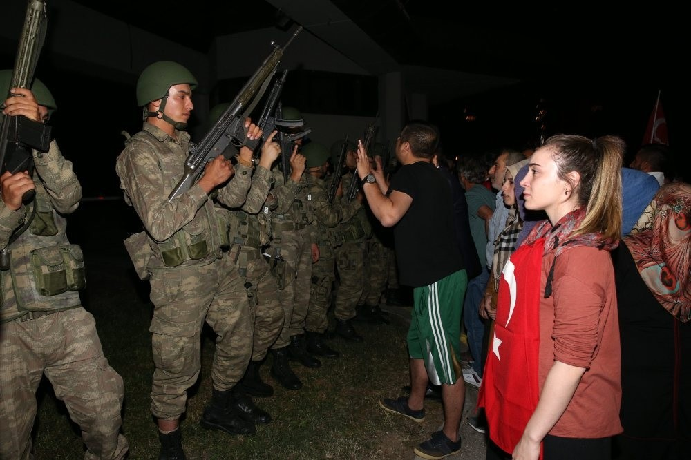 People confront pro-coup soldiers outside TRT headquarters on the coup night. The coup plotters held the public broadcaster's employees hostage for hours before security forces regained control.