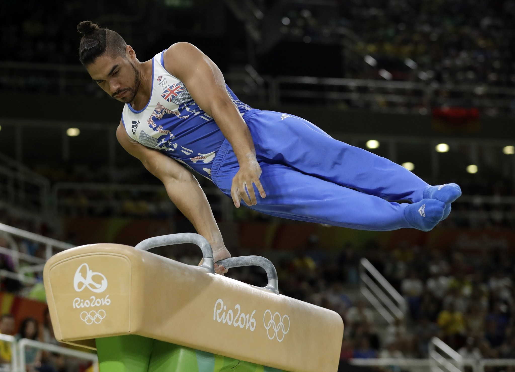 This is an Aug. 14, 2016 file photo of Britain's Louis Smith as he performs on the pommel horse during the artistic gymnastics men's apparatus final at the 2016 Olympics in Rio de Janeiro, Brazil. (AP Photo)