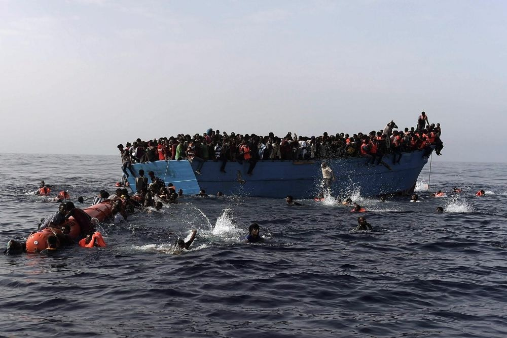 Migrants wait to be rescued in the Mediterranean Sea, some 12 nautical miles north of Libya, on Oct. 4.