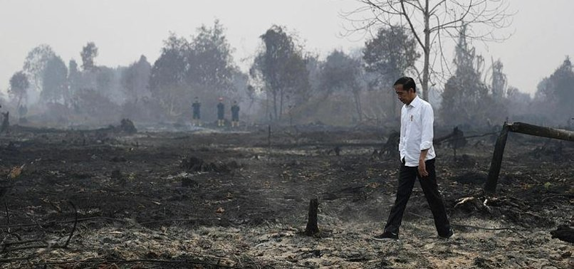 INDONESIAN LEADER PRAYS FOR RAIN IN HAZE-HIT CITY