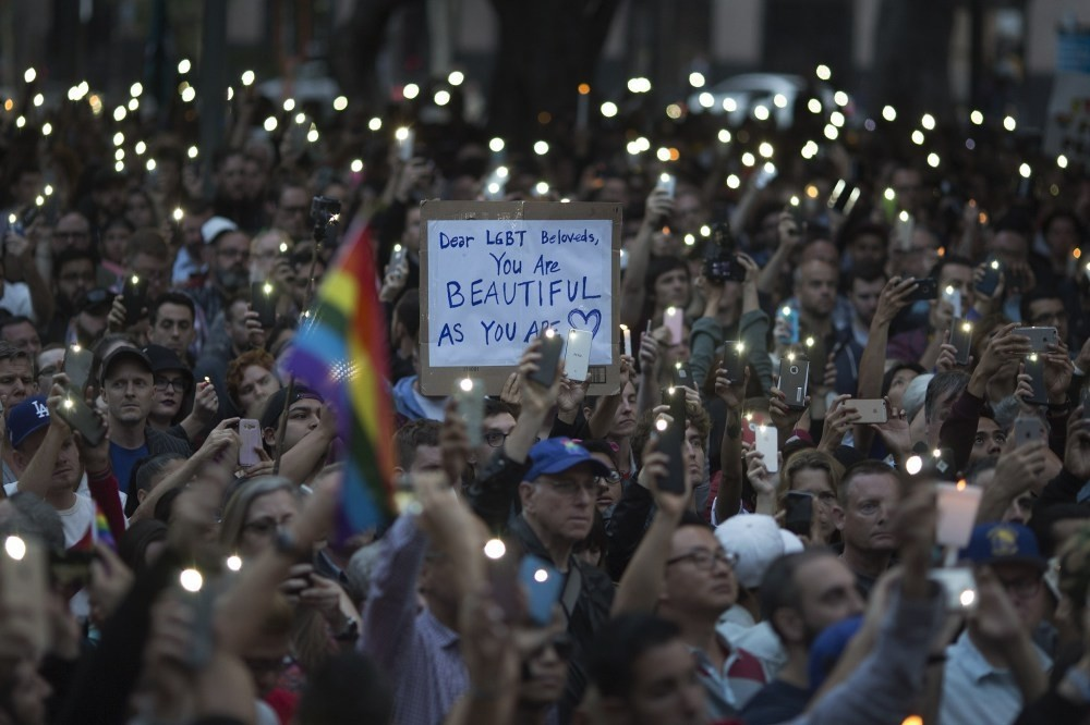 People gathered for a vigil for the mass shooting in Orlando on June 13, 2016 in Los Angeles.