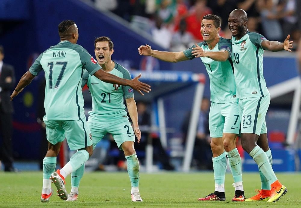 Portugal's Nani celebrates with Cristiano Ronaldo after scoring their second goal (Reuters Photo)