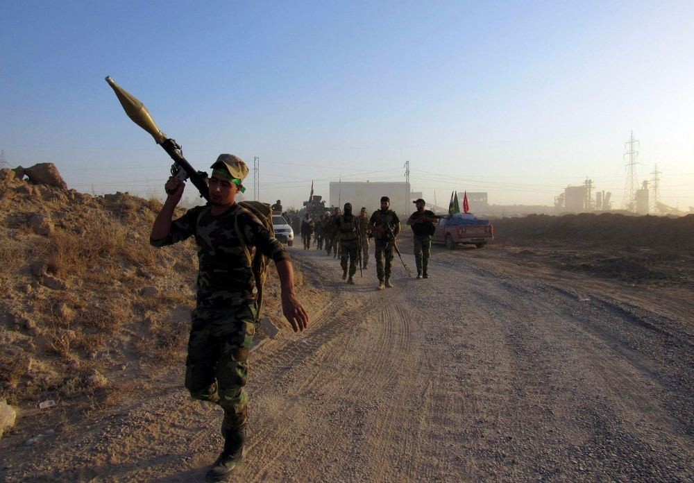 Iraqi forces along with Iranian-backed Shiite militias combat DAESH militants in Fallujah.