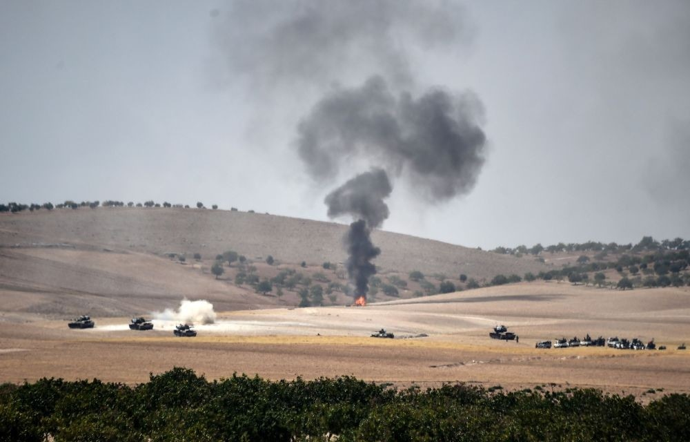 Turkish army tanks and alleged Syrian moderate fighter trucks positioned 2 kilometres west from Jarablus the Syrian town on the border with Turkey, preparing to move position, to Karkamu0131u015f in Turkey's southeastern Gaziantep province, Aug. 24.