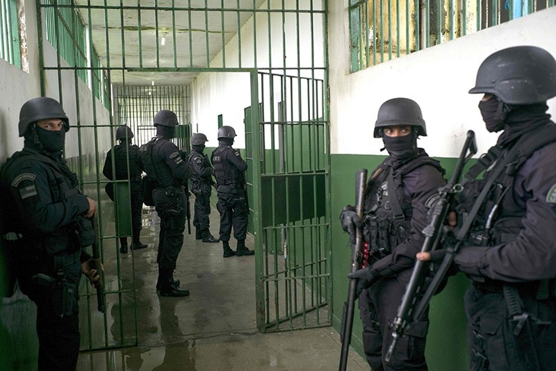 Special Operations Command personnel keep watch during a visit to the Anu00edsio Jobim Penitentiary Complex - where 56 inmates were killed during a riot on two weeks ago, Jan. 14, 2017 in Manaus, Amazonas, Brazil. (AFP Photo)