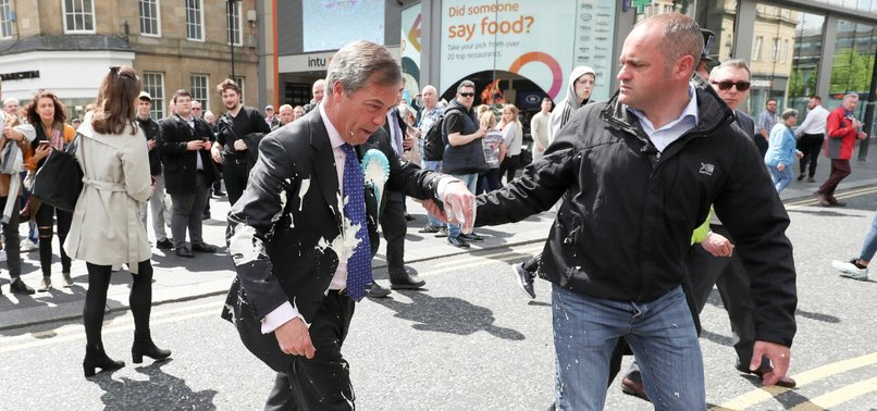 MAN CHARGED WITH THROWING A MILKSHAKE AT BREXIT PARTYS FARAGE