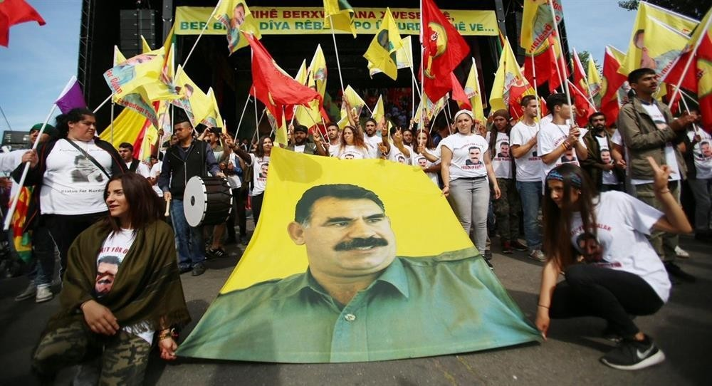 A group of terror supporters organize a gathering freely in Cologne, demonstrating PKK leader u00d6calan's posters and PKK banners