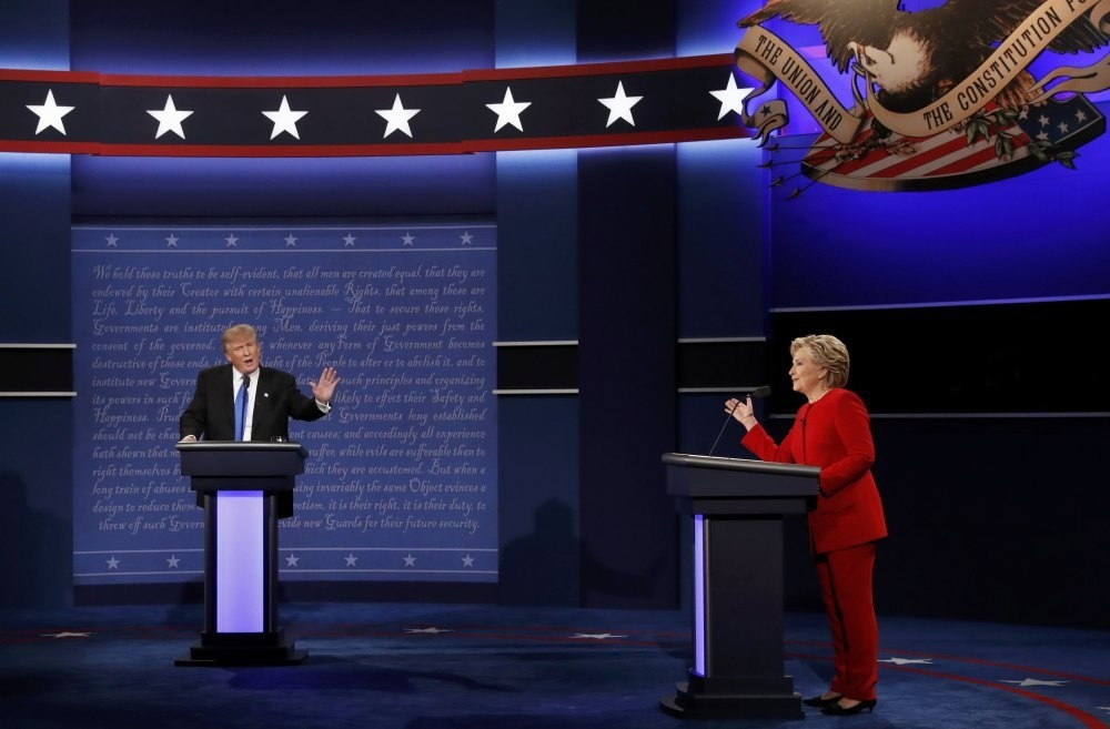 Donald Trump and Hillary Clinton discuss a point during their first presidential debate at Hofstra University in Hempstead, New York, Sept. 26, 2016.