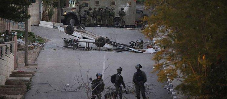 İsrail güçleri Batı Şeria'da 14 Filistinliyi yaraladı