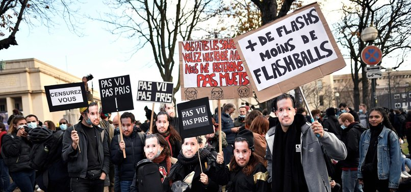 THOUSANDS PROTEST AGAINST FRENCH BILL TO CURB IDENTIFICATION OF POLICE