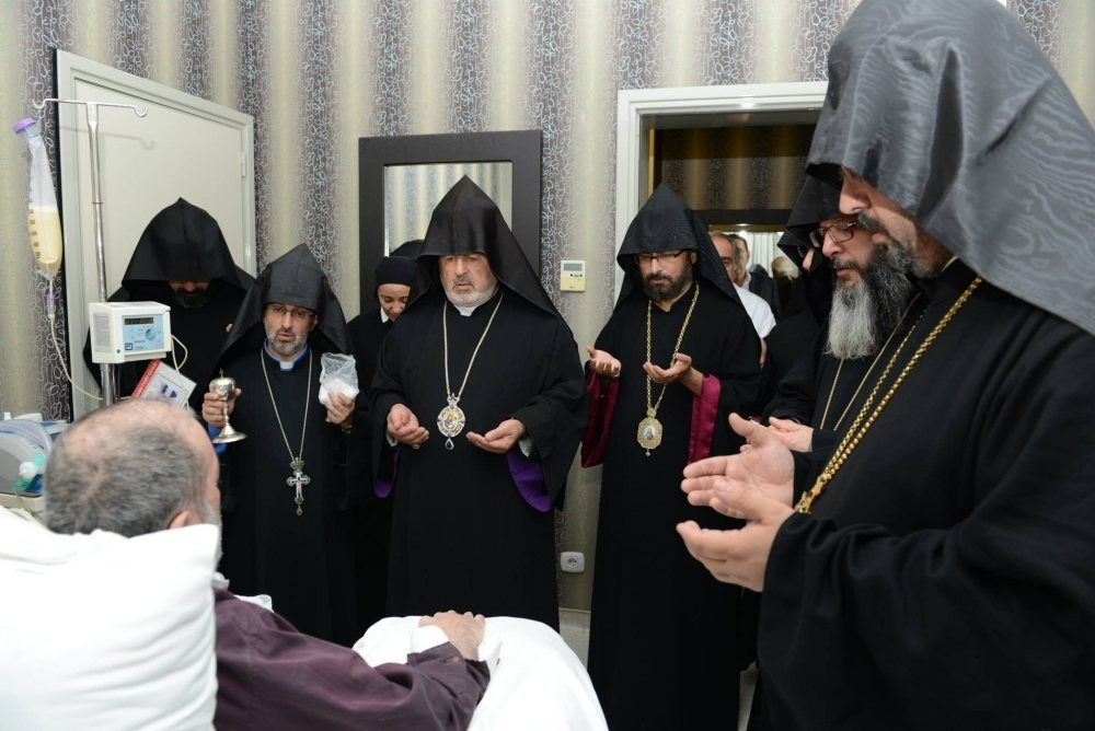 Bishops gather around Patriarch Mesrob II at his hospital room. Mesrob II has been in a vegetative state since 2008.