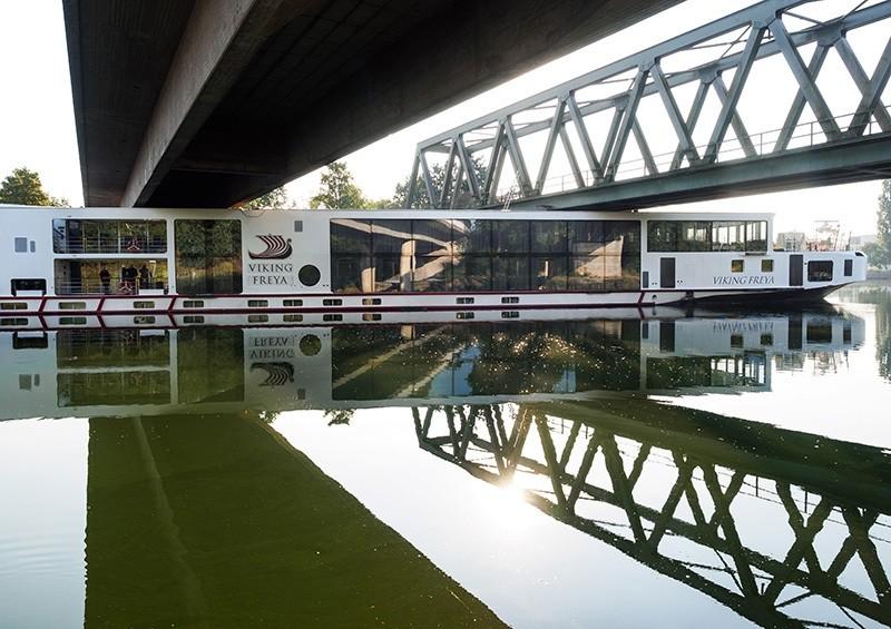 A river cruise ship sticks underneath a railway bridge on the Main-Danube Canal near Erlangen, Germany, Sunday Sept. 11, 2016. (AP Photo)