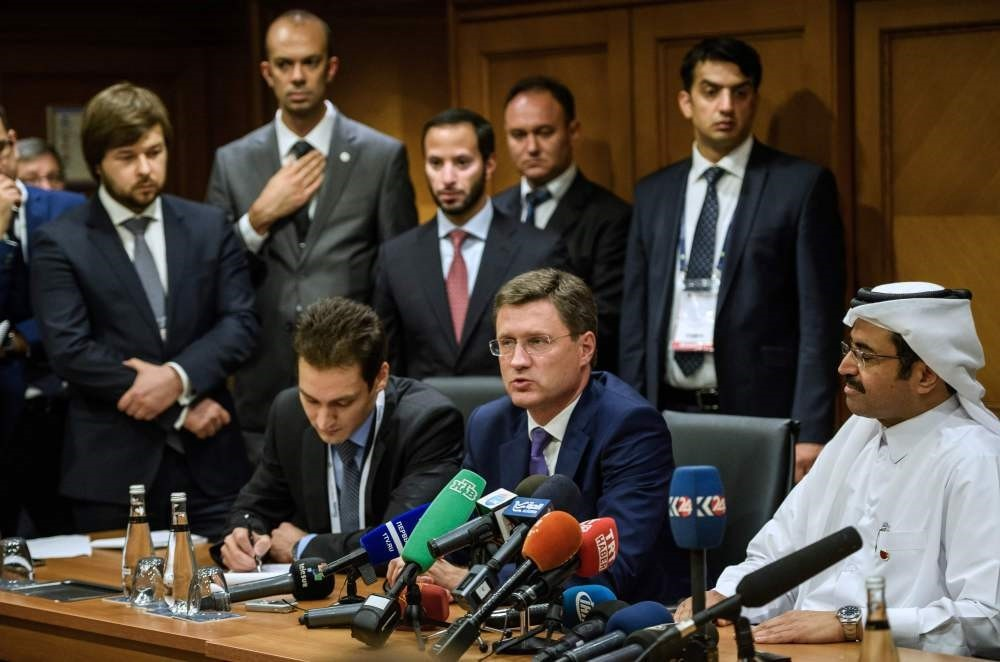Russian Energy Minister Alexander Novak (C) speaks next to Mohammed bin Saleh al-Sada (R), President of OPEC and Qataru2019s Energy Minister during a press conference at the 23rd World Energy Congress in Istanbul Wednesday.