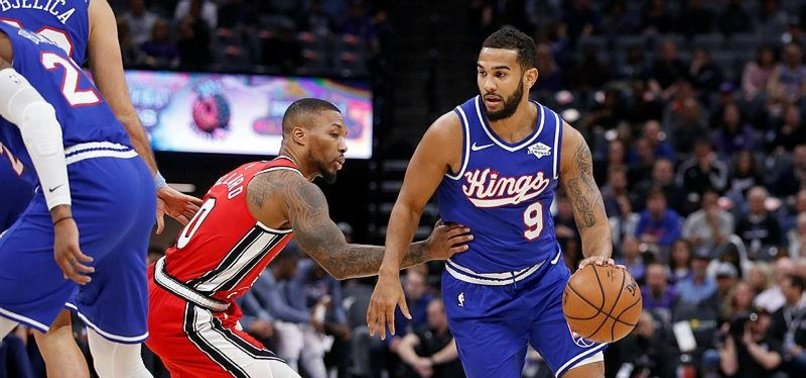 FOX-LESS KINGS BEAT SLUMPING TRAIL BLAZERS 107-99