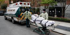 U.S. reports 960 more virus deaths, bringing tally to 103,758