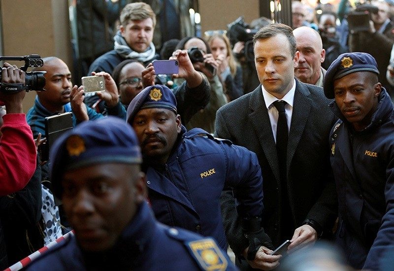 Olympic and Paralympic track star Oscar Pistorius is escorted by police officers as he arrives for his sentencing for the 2013 murder of his girlfriend Reeva Steenkamp, at North Gauteng High Court, Pretoria, S. Africa, July 6, 2016. (Reuters Photo)