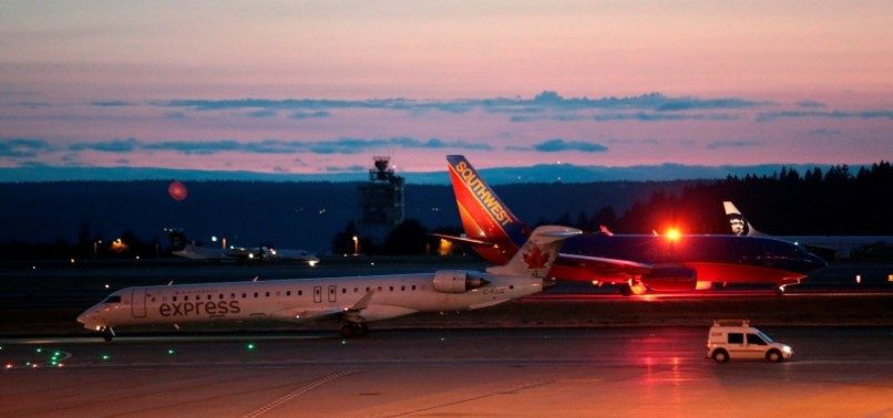 SUICIDAL MECHANIC STEALS PLANE FROM SEATTLE AIRPORT, CRASHES INTO ISLAND