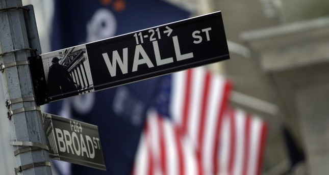 File photo shows a Wall Street sign adjacent to the New York Stock Exchange.