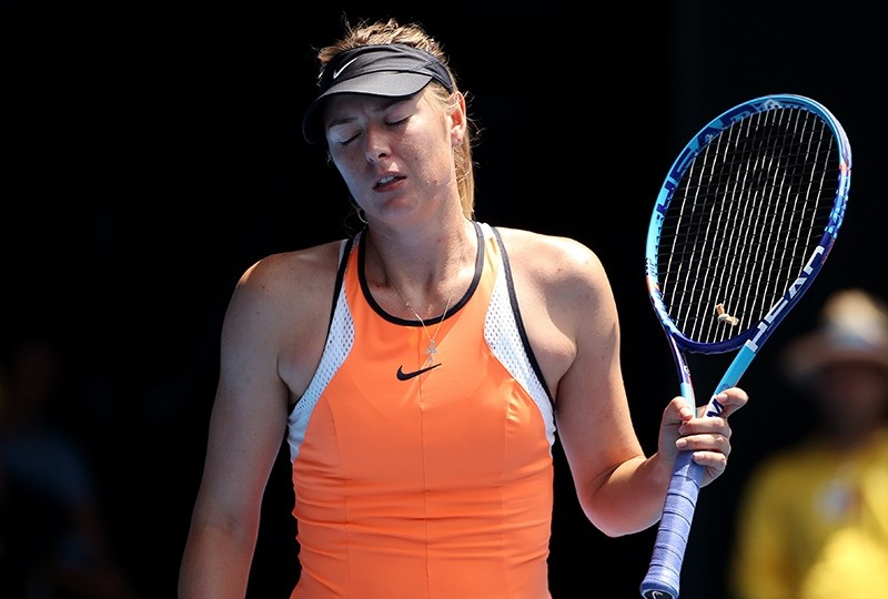 In this Tuesday, Jan. 26, 2016 file photo, Maria Sharapova of Russia reacts after losing a point to Serena Williams of the United States during their quarterfinal match at the Australian Open tennis championships in Melbourne (AP Photo)