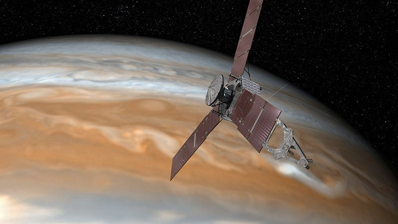 An undated handout image made available by NASA on 16 June 2016 shows an artist's rendering of NASA's Juno spacecraft making one of its close passes over Jupiter. (EPA)