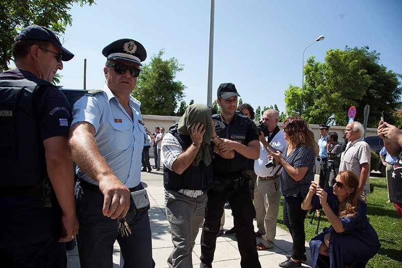 One of the 8 Turkish soldiers who fled to Greece in a helicopter and requested political asylum after a failed military coup against the government, is escorted to courthouse of the n. city of Alexandroupolis, Greece, July 21, 2016. (Reuters Photo)