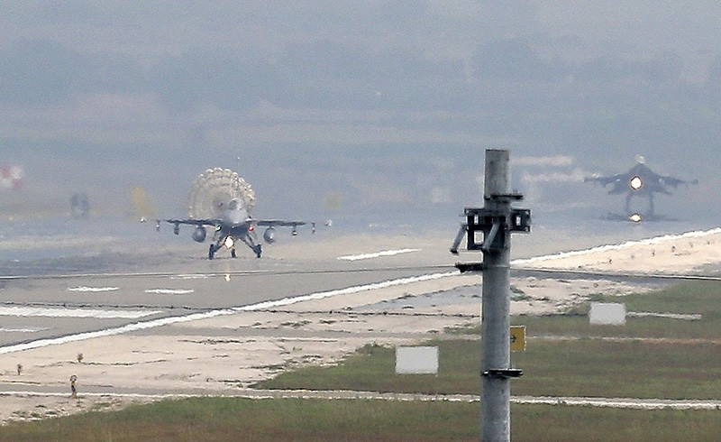 Turkish Air Force fighter planes land at u0130ncirlik Air Base, on the outskirts of the city of Adana, southern Turkey, July 30, 2015. (AP Photo)