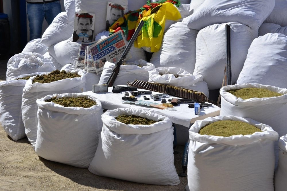 Sacks of cannabis seized in Diyarbaku0131r on display. On the far left are pictures of Abdullah u00d6calan, jailed leader of the PKK and Zaman newspaper, a now-defunct Gu00fclenist mouthpiece, found in the raid against PKK-linked drug traffickers