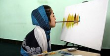 Disabled Afghani girl makes living by selling paintings