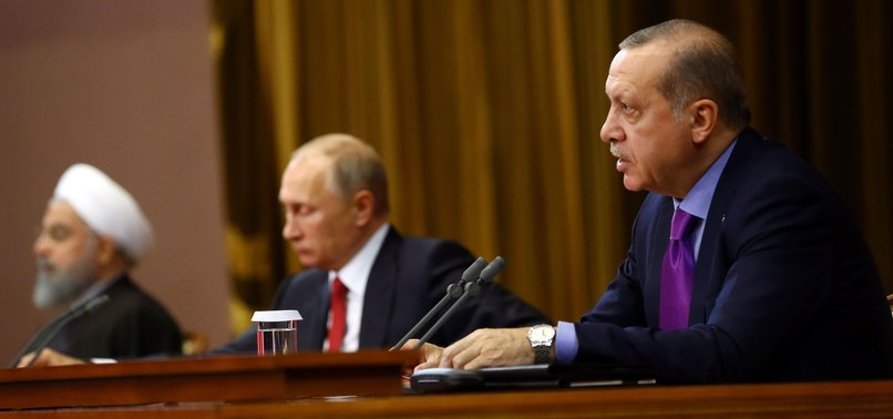 TURKEY, RUSSIA, IRAN AGREE TO WORK TOGETHER TO EASE SYRIA TENSIONS
