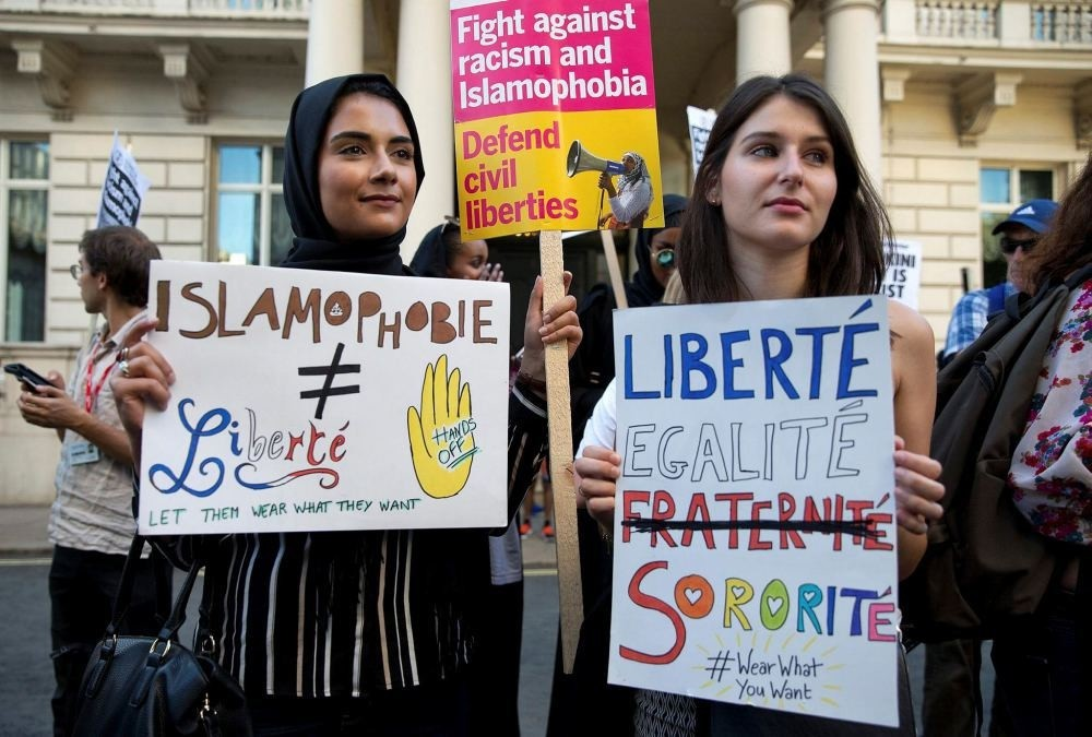 Women join a demonstration organized by ,Stand up to Racism, outside the French Embassy in London on Aug. 26 against the Burkini ban on French beaches.