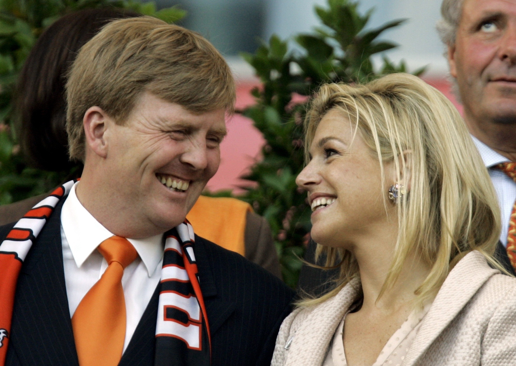 Netherlands' Prince Willem Alexander, left, and Princess Maxima wait for the beginning of the World Cup Group C soccer match between the Netherlands and Argentina. (AP Photo)