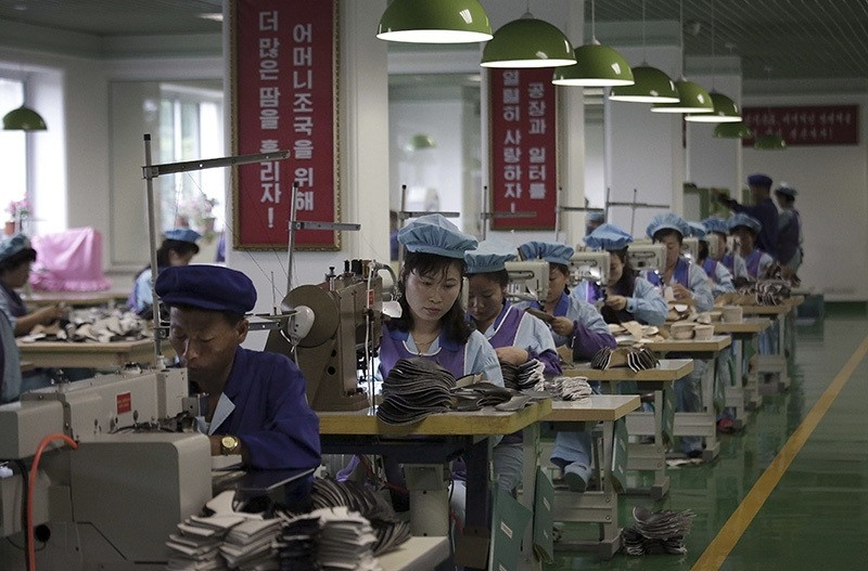 Factory workers operate sewing machines at a shoe factory in Wonsan, North Korea. (AP Photo)