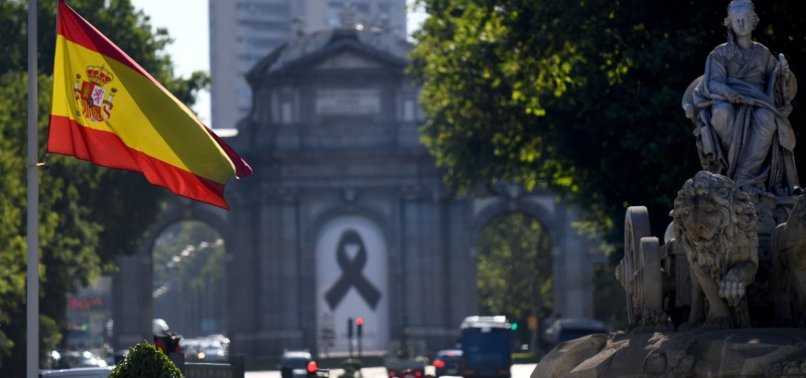 WITH BLACK MASKS AND SILENCE, SPAIN MOURNS ITS CORONAVIRUS DEAD
